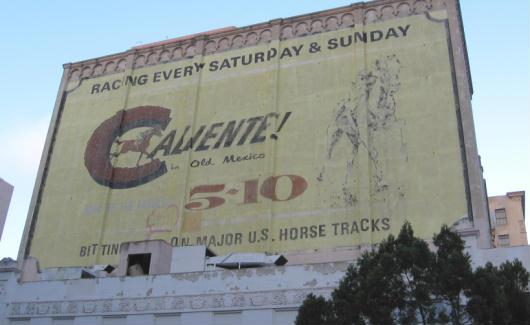 caliente racing ad on san diego building