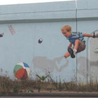 Mission Valley mural of kids at play.