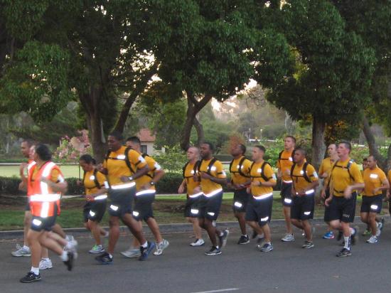 military recruits jog through Balboa Park