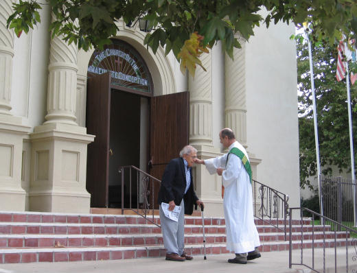 priest on steps of historic old town church