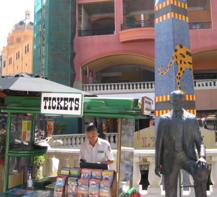 horton plaza statue beside ticket lady