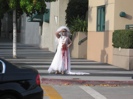 a bride zombie approaches the city park