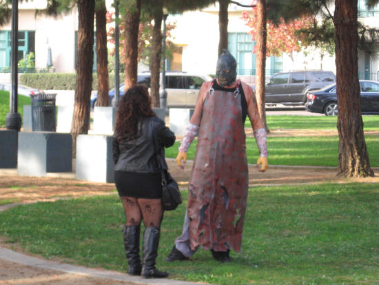 an executioner zombie examines his next victim