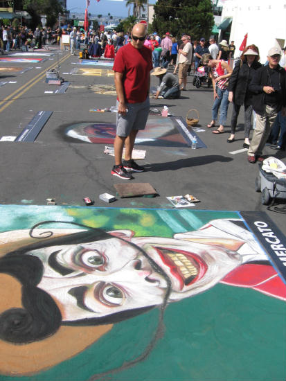 crazy colorful chalk art face in little italy