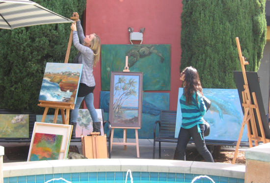 festa artist sets up some paintings
