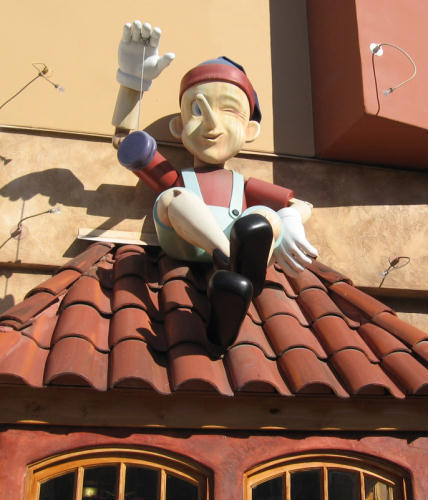 giant pinocchio sits on tile roof