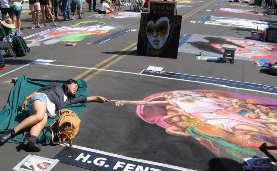 girl touches finger of michelangelo chalk art god