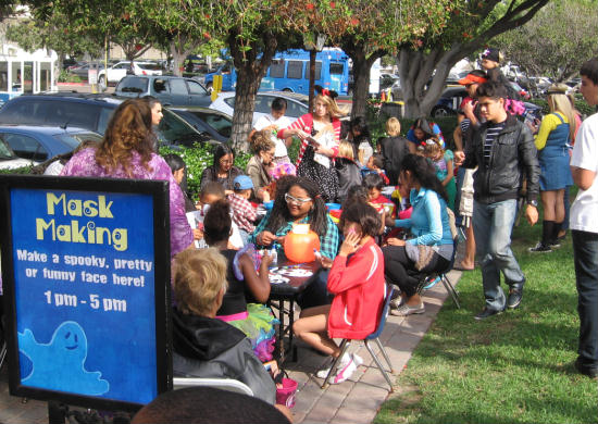 kids at seaport village making halloween masks