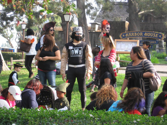 lots of adults join in halloween fun at seaport village