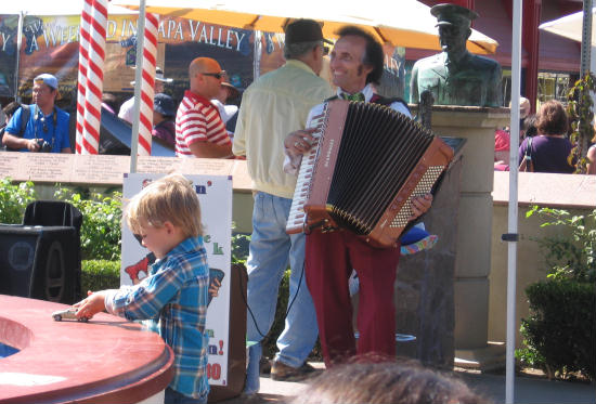 musician plays accordion at italian festa