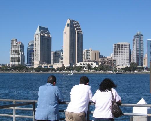 people gaze toward downtown from ferry landing