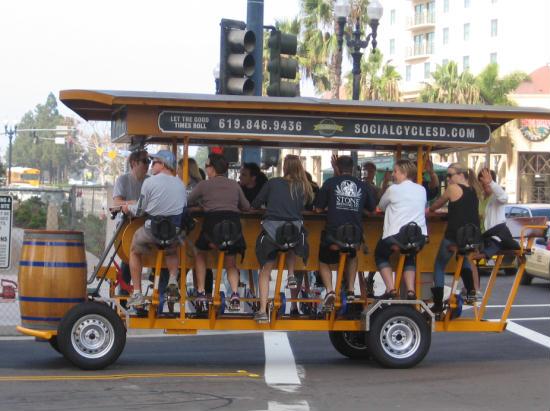 twelve-person bicycle heads down street