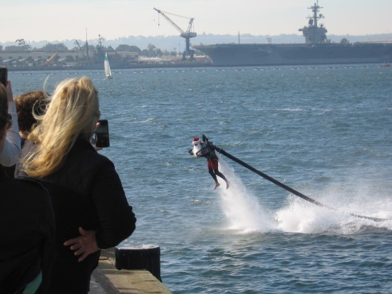 here comes santa claus with a water jetpack