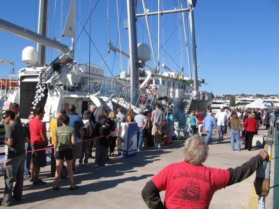 visitors board the greenpeace rainbow warrior ship