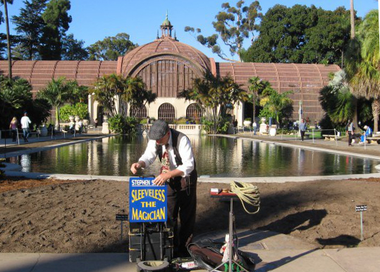 sleeveless magician sets up in balboa park
