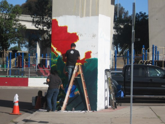 01 Artists paint image of Mexico on pillar in Chicano Park.