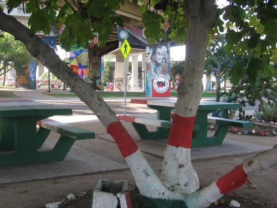 Painted tree trunks and picnic benches at Chicano Park.