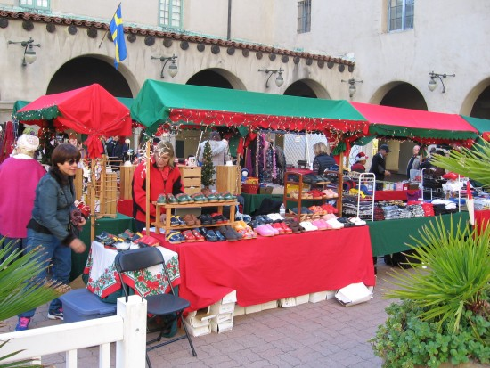 Vendors set up festive booths in courtyard in front of the Museum of Man.
