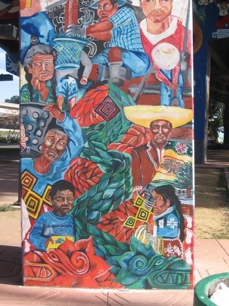02 Colorful folk depicted in art on a freeway pillar.