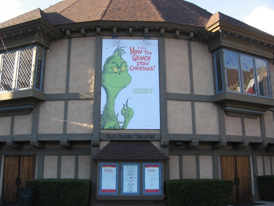 Front of the Old Globe Theatre features a banner of the Dr. Seuss Grinch.
