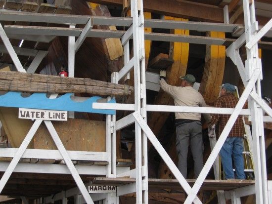 05 Volunteers work on the wooden hull of Maritime Museum's San Salvador ship.