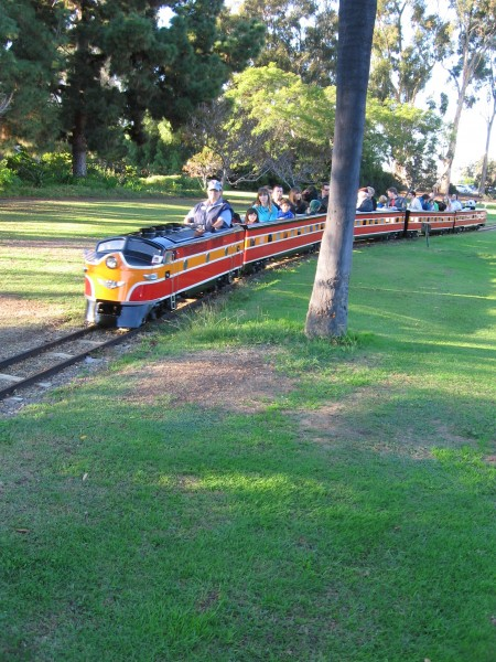 People ride the Balboa Park Miniature Railroad.