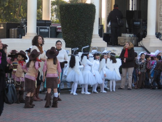 Tijuana school kids dressed as vaqueros and angels wait to perform at December Nights.