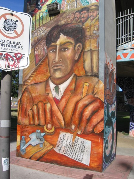 A nearby mural depicts a moment in history.