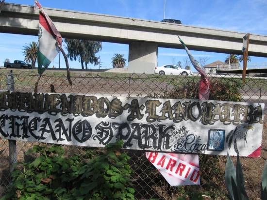 Chicano Park sign and Mexican flags beside Interstate 5.