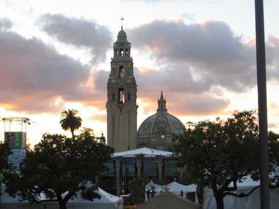 A December day fades above Balboa Park and the clouds are tinged with color.