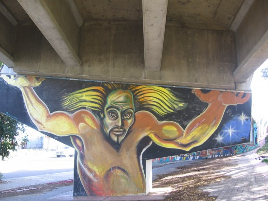 18 Wild-haired figure holds up freeway with huge hands!