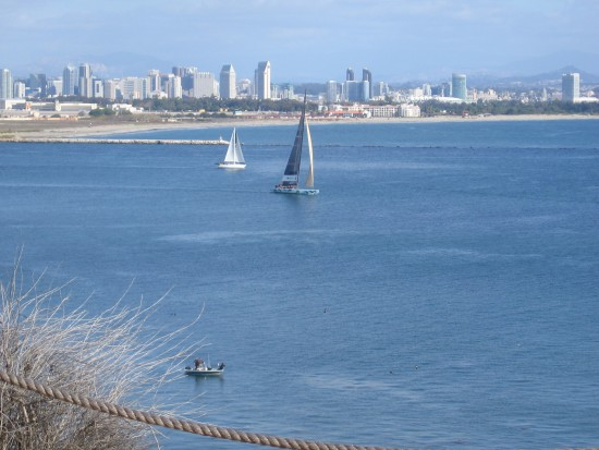 26 America's Cup boat Abracadabra sails down the San Diego channel.
