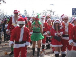 A mob of Santas and one green elf.