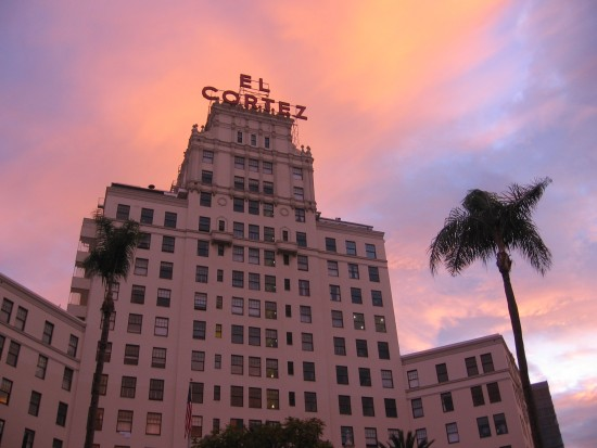 Beautiful sunrise colors clouds above El Cortez Hotel.
