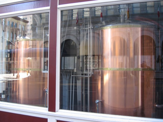 Beer fermentation tanks in a downtown San Diego window.