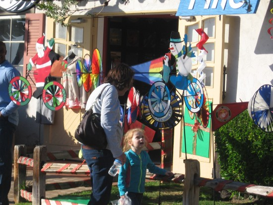 Child takes delight at the Kite Flite shop in Seaport Village.