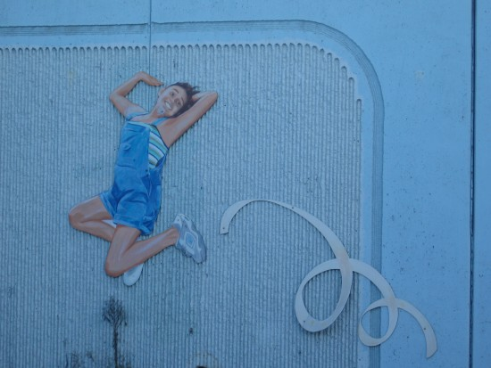 Girl jumps on beloved mural beside Interstate 8.
