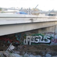 Homeless and graffiti under Highway 163.