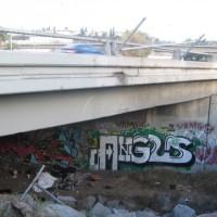Homeless and graffiti under Highway 163.