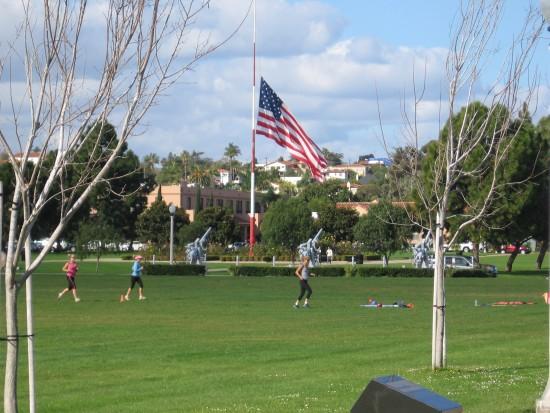 Huge Liberty Station flag at half mast.