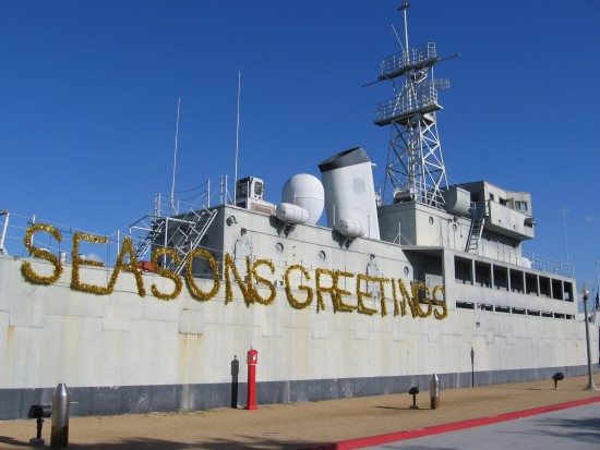 USS Recruit with Seasons Greetings sign.