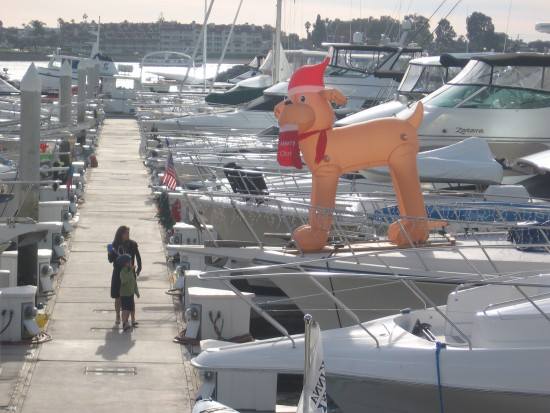 Inflatable Christmas dog decorates boat in Marriott Marina.