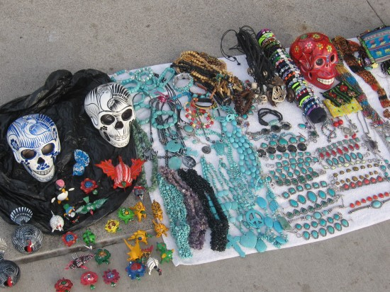 Painted skulls, beads and assorted Mexican trinkets.