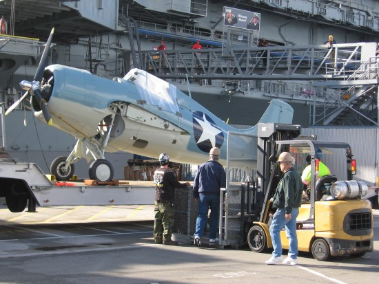 Preparing to lift Wildcat onto USS Midway's elevator.
