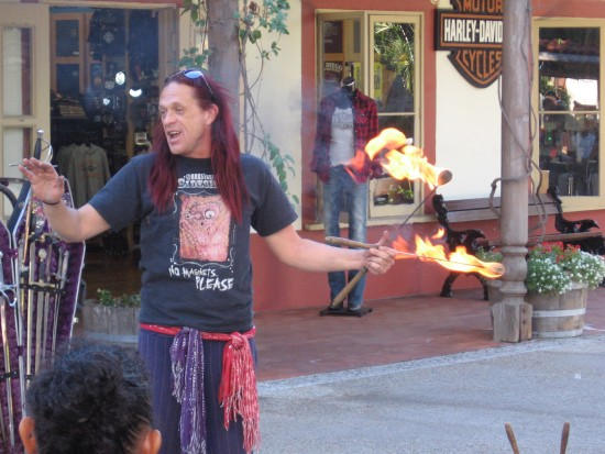 Seaport Village street performer prepares to swallow fire.