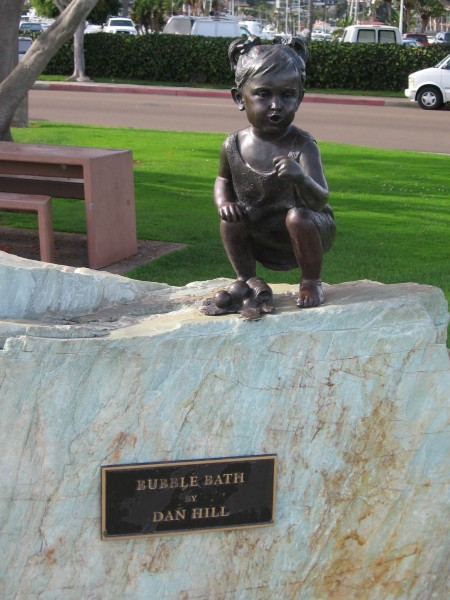 Small bubble bath child bronze sculpture.