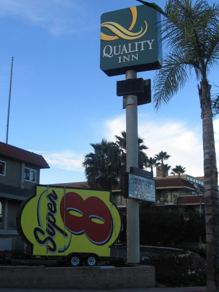 Super 8 sign stays at a Quality Inn.