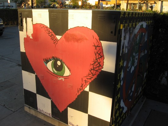 The heart's persistent eye stares out at the city.