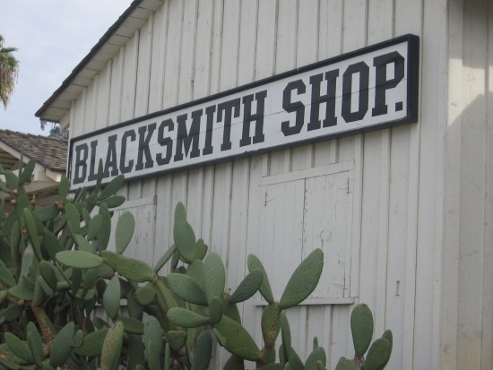 Sign on the Blacksmith Shop behind Seeley Stable.