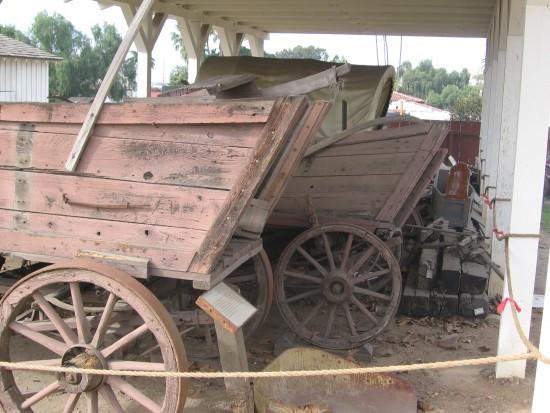 Several unrestored wagons.
